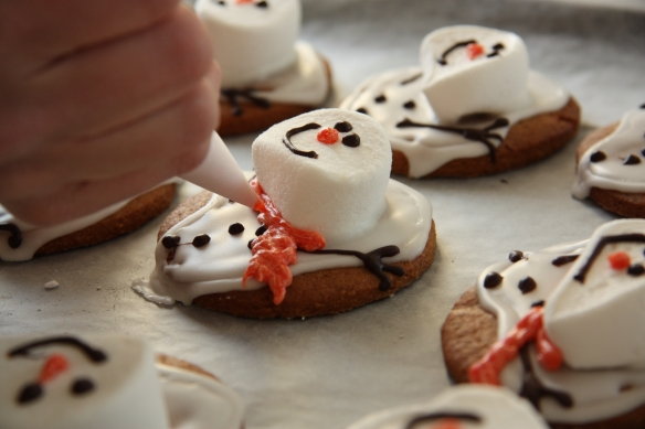 making melting snowman cookies